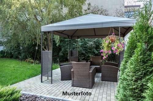 Einfamilienhaus mit schön gestaltetem Garten