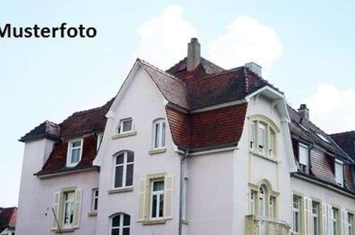 Wohn- und Geschäftshaus mit Terrasse