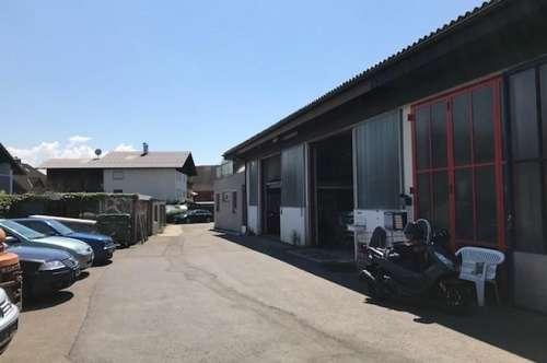 Wohn- und Geschäftshaus mit Werkstatt, Garagen und Lager