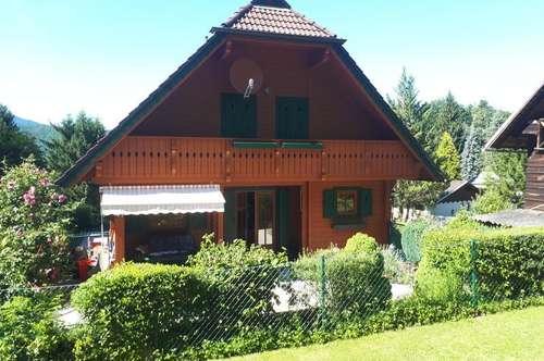 Holzblockhaus mit 2000m² Baugrund und Wörtherseesicht