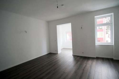 Toprenovierte 120 m² große Maisonette-Wohnung mit privatem Garten - ERSTBEZUG