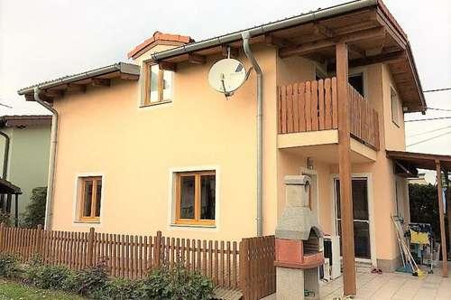 Haus auf Doppelparzelle in Kleingartensiedlung