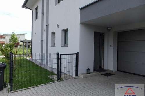 Neuwertiges Wohnhaus mit sonnigem Garten !