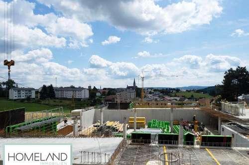 Vier-Zimmer Neubauwohnung mit großzügiger Terrasse und Eigengarten
