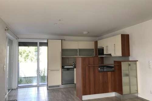 Wohnung mit Terrasse und Gartenanteil in einem Zweifamilienhaus