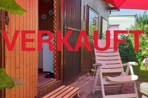 VERKAUFT! GRÜNOASE mit gemütlichem Holzhaus