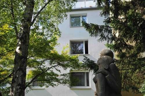 Wohnen im Gartengebäude mit altem Baumbestand