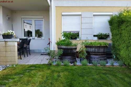 Lichtdurchflutete Gartenwohnung mit eigenem Tiefgaragen-und Abstellplatz
