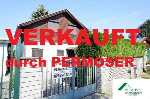 Ferienhaus auf Uferparzelle (Pachtgrund) mit separatem Parkplatz mit Carport