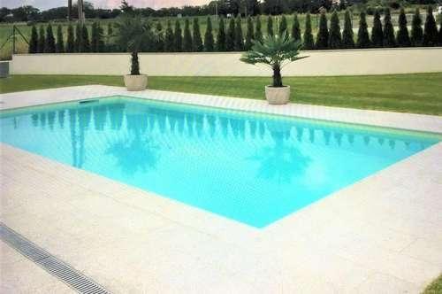 In grüner Ruhelage Hornsteins - Einfamilienhaus auf einer Ebene mit beheizbarem Pool