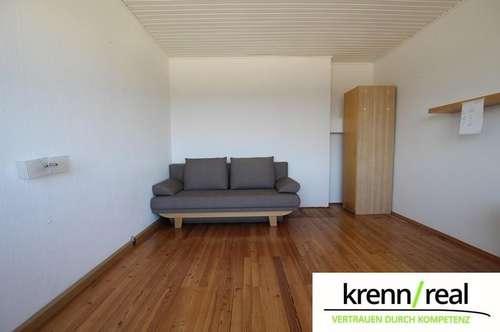 Helle Eigentumswohnung mit Garage und 2 Kfz-Abstellplätzen!