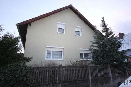 PAUL & PARTNER: Einfamilienhaus mit südseitiger Terrasse in schöner Siedlungslage