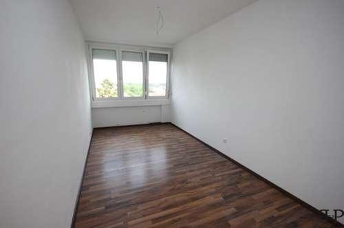NEU: ERSTBEZUG: 3-Zimmer mit traumhafter Aussicht aus dem 6. Stock + 7 m² Loggia + überdachter Stellplatz