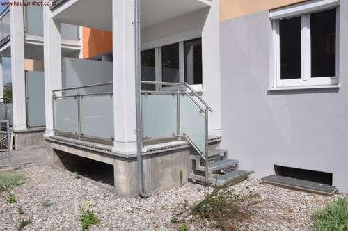 Hochparterre-Wohnung mit Eigengarten und zwei Loggien