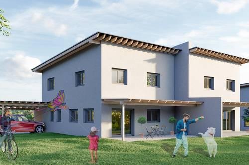 """Familienfreundliches Doppelhaus """"Rainbow"""" ca. 119 m² inkl. eigenem Grundstück, Carport und zusätzlichem Abstellplatz"""