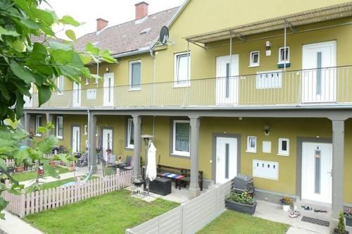 Moderne 2-Zimmer Erdgeschosswohnung mit Gartenanteil in ruhiger Grünlage!