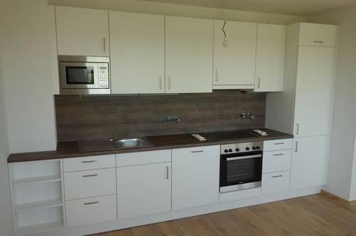 TOP-Wohnung mit Einbauküche, Balkon, Erdwärme und Deckenkühlung