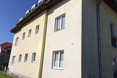 1-Zimmer-Wohnung im Erdgeschoss und PKW-Stellplatz im Freien