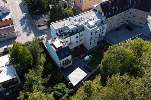 Erstbezugs - Immobilie mit Carport und Balkon mit Blick ins Grüne zzgl. GRATIS € 5.000,-- Möbelgutschein !