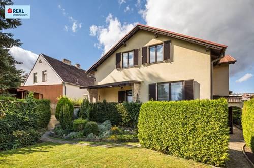Einfamilienhaus mit liebevollem Garten, Terrasse, Keller und Garage