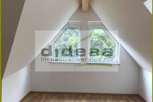 Dachgeschoßwohnung mit Garten