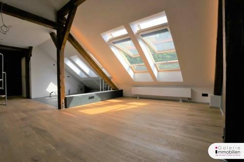 Exklusiv ausgestattete Dachgeschoßwohnung mit Grünblick, Eigengarten und Parkplatz