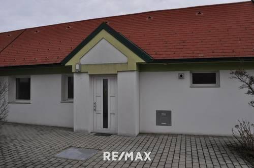 Ebenerdige Wohnung mit Terrasse und kleinem Garten