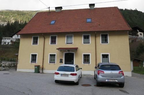Mehrfamilienwohnhaus mit Garten und Pool