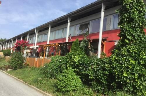 Erdgeschoßwohnung mit Terrasse, Gartenanteil und PKW-Abstellplatz