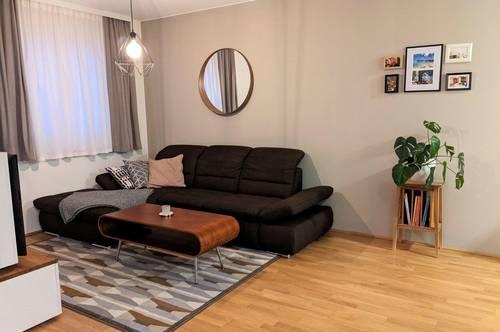 Wohnung mit 200 m² Eigengarten und 2 Tiefgaragenplätzen