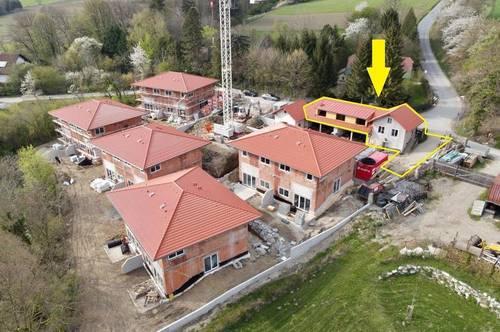 Helle großzügige Eigentumswohnung mit Eigengarten mitten im Wienerwald!