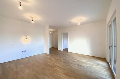 ERSTBEZUG: 2-Zimmer-Wohnung mit Garten und Garage