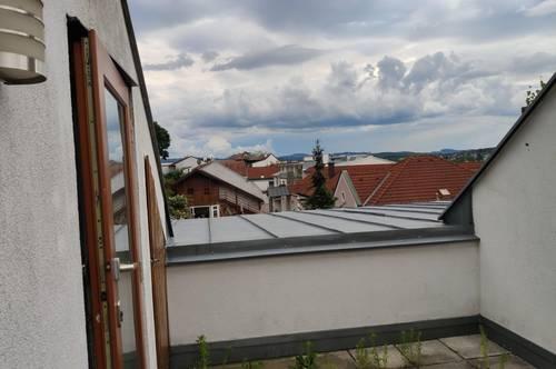 3% Nettorendite: vermietete Dachterrassenwohnung in Top-Lage inklusive Garagenplatz