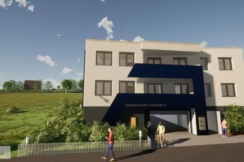 große, stylische Eigentumswohnung mit Eigengarten und Tiefgaragenplatz - NEUBAU
