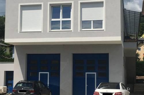 2 Wohnungen und eine Gewerbefläche im EG