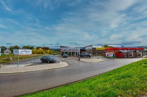 Autoverkaufsstätte mit neuer Werkstatt an Top-Standort!
