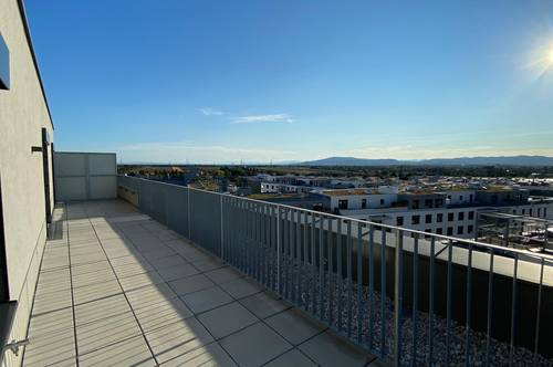 Provisionsfreie traum Dachterrassenwohnung Erstbezug neben U1 und Therme Wien mit tollem Fernblick.