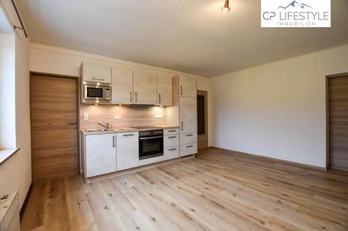 Hochwertig renovierte Etagenwohnung mit Blick bis zum Kitzsteinhorn