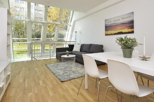Sonniges 2-Zimmer-Loft mit Garten und TG