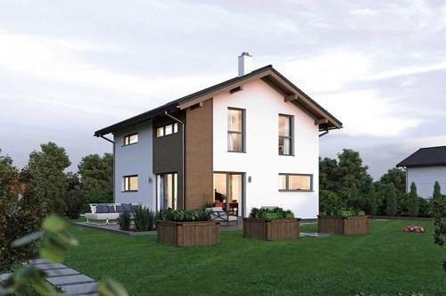 Wohnhausneubau: ein ELK Fertighaus auf einem sonnigen Grundstück mit Grimmingblick