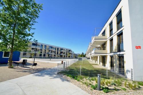 Sonnige 2 Zimmer Terrassenmiete mit Westterrasse, Tiefgaragenplatz & Gartenblick